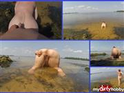 Snejka – pissing in the dog pose on the beach (3)