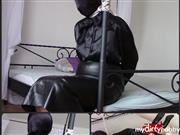 bondageangel – With handcuffs and hood in a long leather skirt